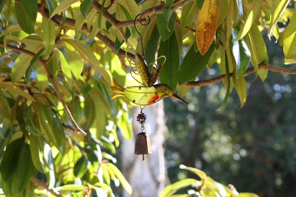 Hummingbird ornament in garden