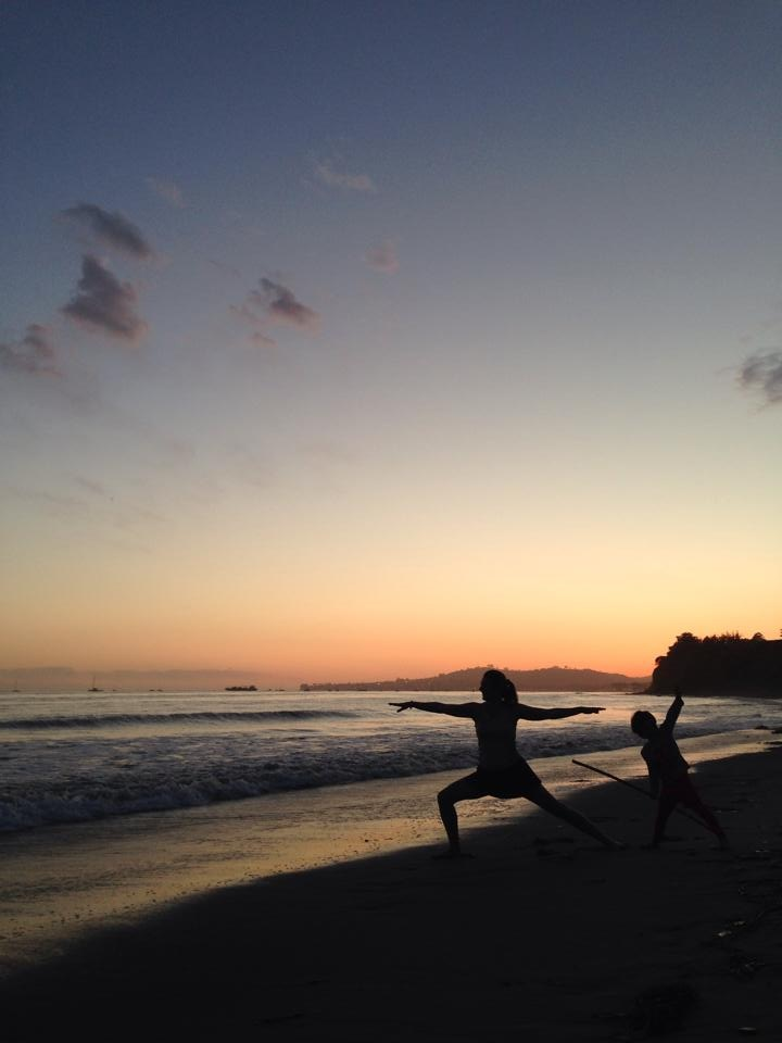 Warrior pose with Miss 4 at Butterfly Beach