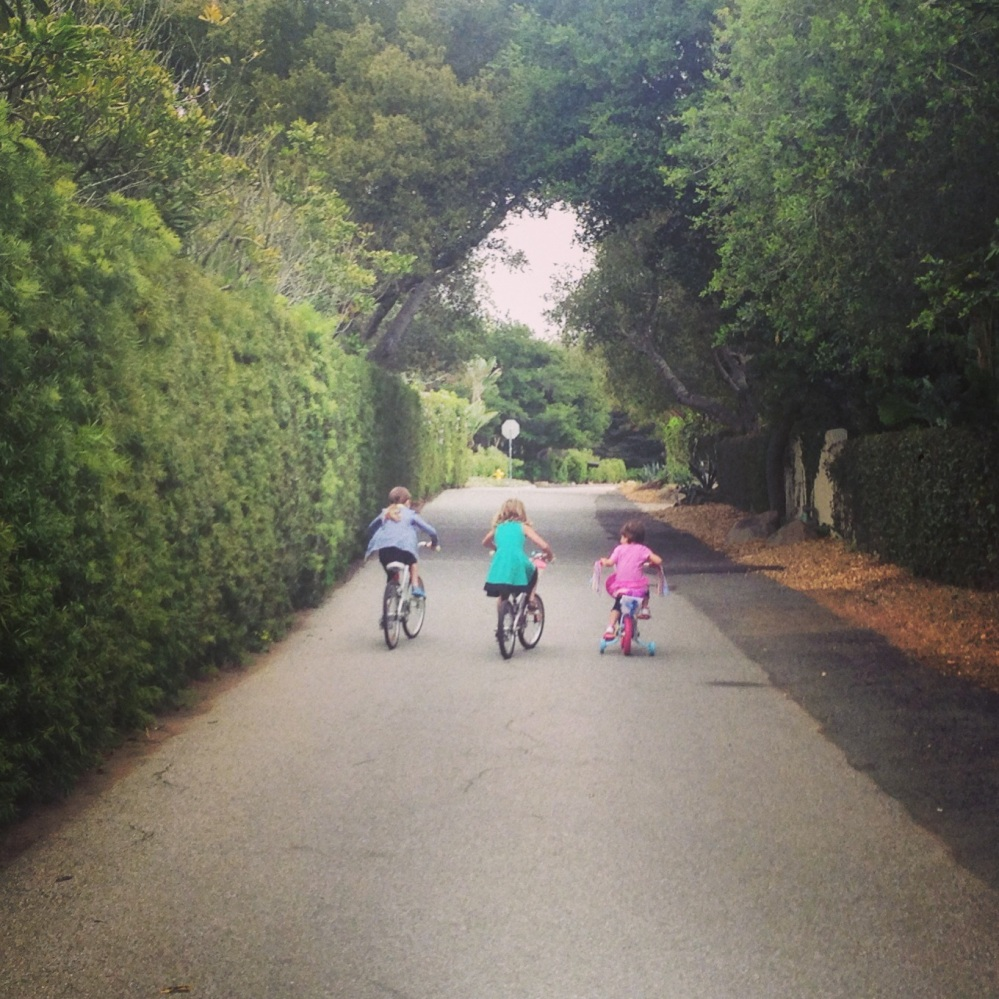 Sisters riding their bikes together