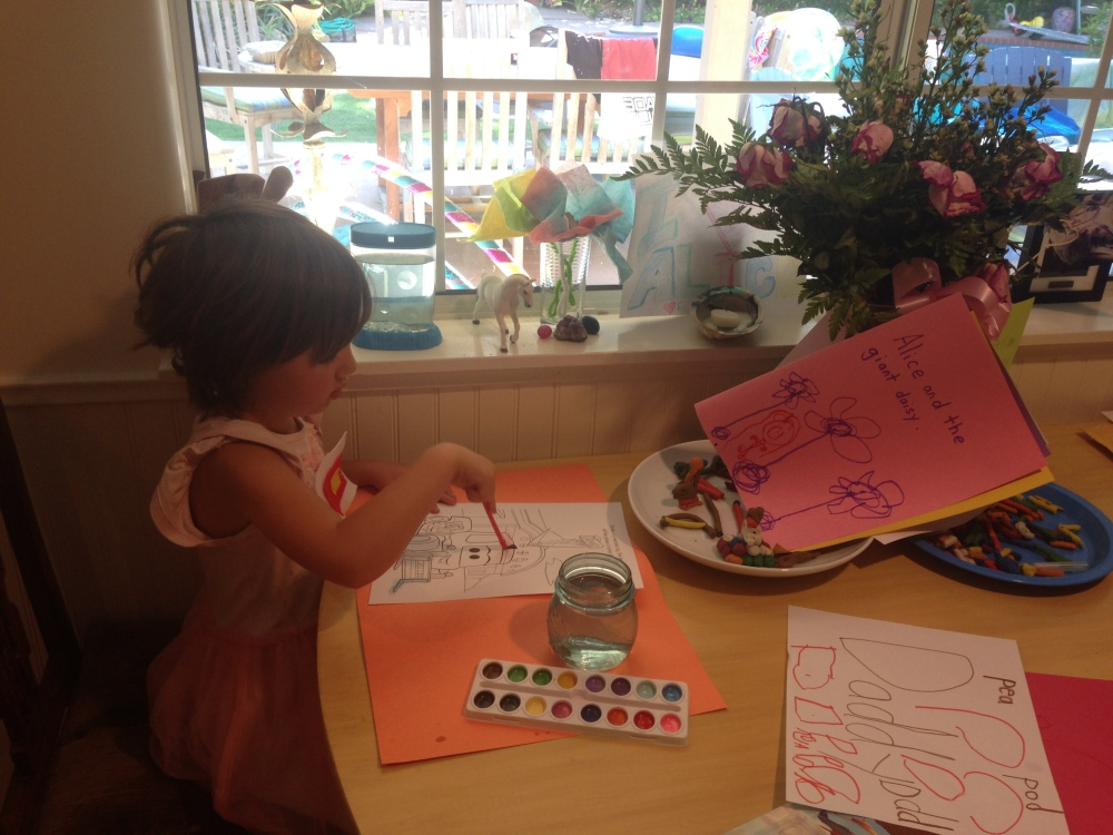 Miss 4 painting, writing and drawing