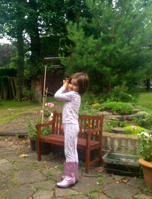 Our Kiwi born girl, in her p-jays in Grandma & Granddad's garden in England, wearing her cow-girl boots from her Californian adventures.