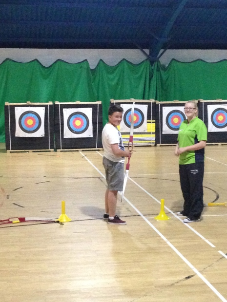 Cousin Daniel preparing for archery